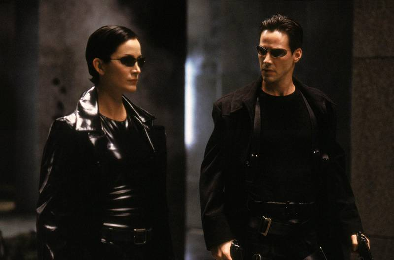 Carrie Anne-Moss annd Keanu Reeves in The Matrix. Courtesy Warner Bros.