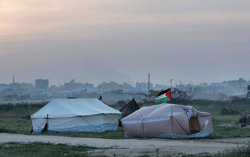 Palestinians are setting up tents in preparation for mass demonstrations along the Gaza strip border with Israel, in eastern Gaza City, Tuesday, March 27, 2018. Gaza's embattled Hamas rulers are imploring hundreds of thousands of people to march along the border with Israel in the coming weeks -- a high risk gambit meant to shore up their shaky rule, but with potentially deadly consequences. (AP Photo/Adel Hana)