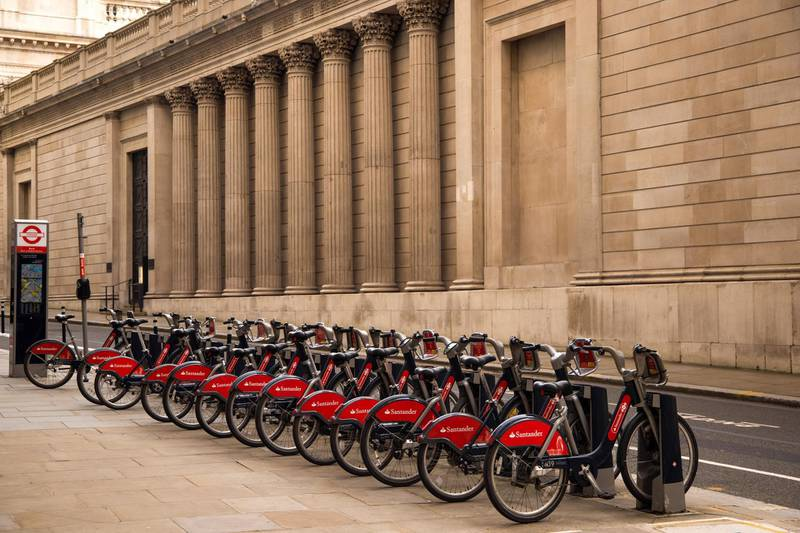 A rack of Santader hire bikes outside the Bank of England in the City of London, U.K., on Monday, March 8, 2021. Values in the U.K. capital should jump about 25% over the next five years, outpacing other European capitals, according to DWS researchers. Photographer: Jason Alden/Bloomberg