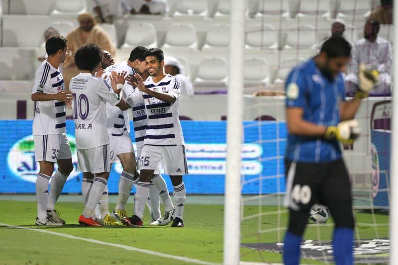 Al Ain, United Arab Emirates, Jan 26, 2013 -  Al Ain players celebrate the 4-0 goal against  Ajman at Tahnon bin Mohamed Stadium.  ( Jaime Puebla / The National Newspaper )