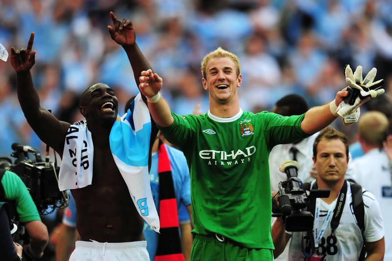 LONDON, ENGLAND - MAY 14: Joe Hart the Manchester City goalkeeper and team mate Micah Richards celebrate following their victory during the FA Cup sponsored by E.ON Final match between Manchester City and Stoke City at Wembley Stadium on May 14, 2011 in London, England. (Photo by Shaun Botterill/Getty Images)