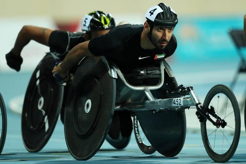 epa07999796 Mohamed Al Haammadi of UAE leads to win in the men's 800m T34 final at the World Para Athletics Championships in Dubai, United Arab Emirates, 15 November 2019.  EPA/MAHMOUD KHALED