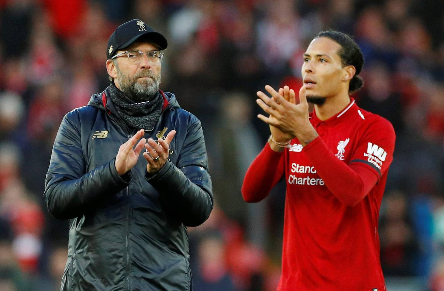 """Soccer Football - Premier League - Liverpool v AFC Bournemouth - Anfield, Liverpool, Britain - February 9, 2019  Liverpool manager Juergen Klopp and Liverpool's Virgil van Dijk celebrate after the match                  REUTERS/Phil Noble  EDITORIAL USE ONLY. No use with unauthorized audio, video, data, fixture lists, club/league logos or """"live"""" services. Online in-match use limited to 75 images, no video emulation. No use in betting, games or single club/league/player publications.  Please contact your account representative for further details."""