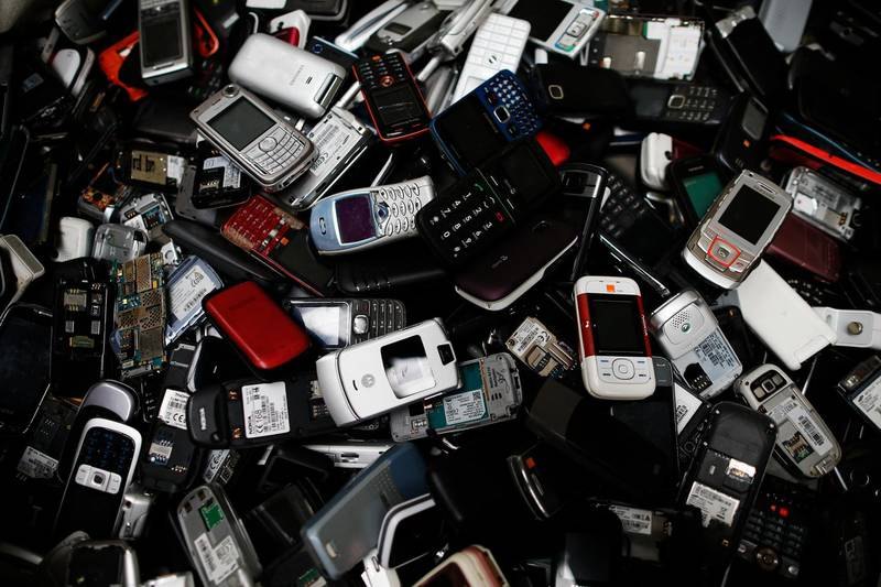This photo taken on May 3, 2017 at Morphosis plant in Le Havre, northwestern France, shows a pile of discarded electrical and electronic components. - Morphosis extracts and refines rare and precious metals from electrical and electronic devices in Europe. (Photo by CHARLY TRIBALLEAU / AFP)