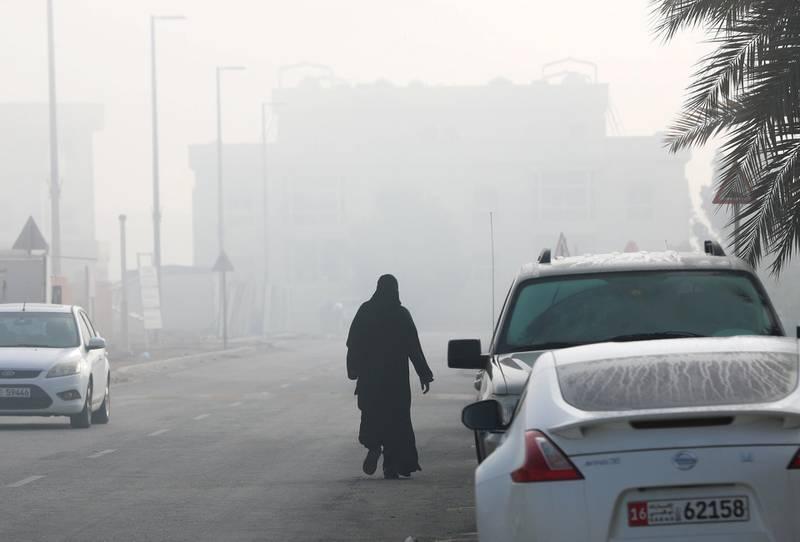 Khalifa City, Abu Dhabi, March 6, 2018.  A lady takes her morning walk amidst the fog at the Khalifa City A neighborhood.Victor Besa / The National