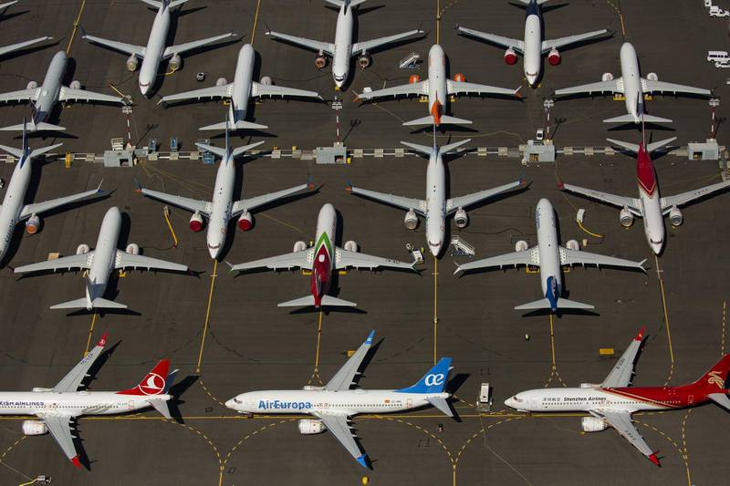 (FILES) In this file photo taken on August 13, 2019, Boeing 737 MAX airplanes are seen parked near Boeing Field in Seattle, Washington.    Nearly six months after its 737 MAX jets were grounded, Boeing is now close to applying to recertify the aircraft, according to sources, but the timeframe for flights to resume remains murky. Regulators will have final say on when the planes to return to service, clouding the outlook, in part because of signs of discord between US and international regulators. / AFP / GETTY IMAGES NORTH AMERICA / David Ryder