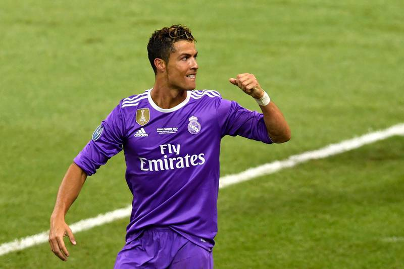 CARDIFF, WALES - JUNE 03:  In this handout image provided by UEFA, Cristiano Ronaldo of Real Madrid celebrates scoring his sides third goal during the UEFA Champions League Final between Juventus and Real Madrid at National Stadium of Wales on June 3, 2017 in Cardiff, Wales.  (Photo by Handout/UEFA via Getty Images)