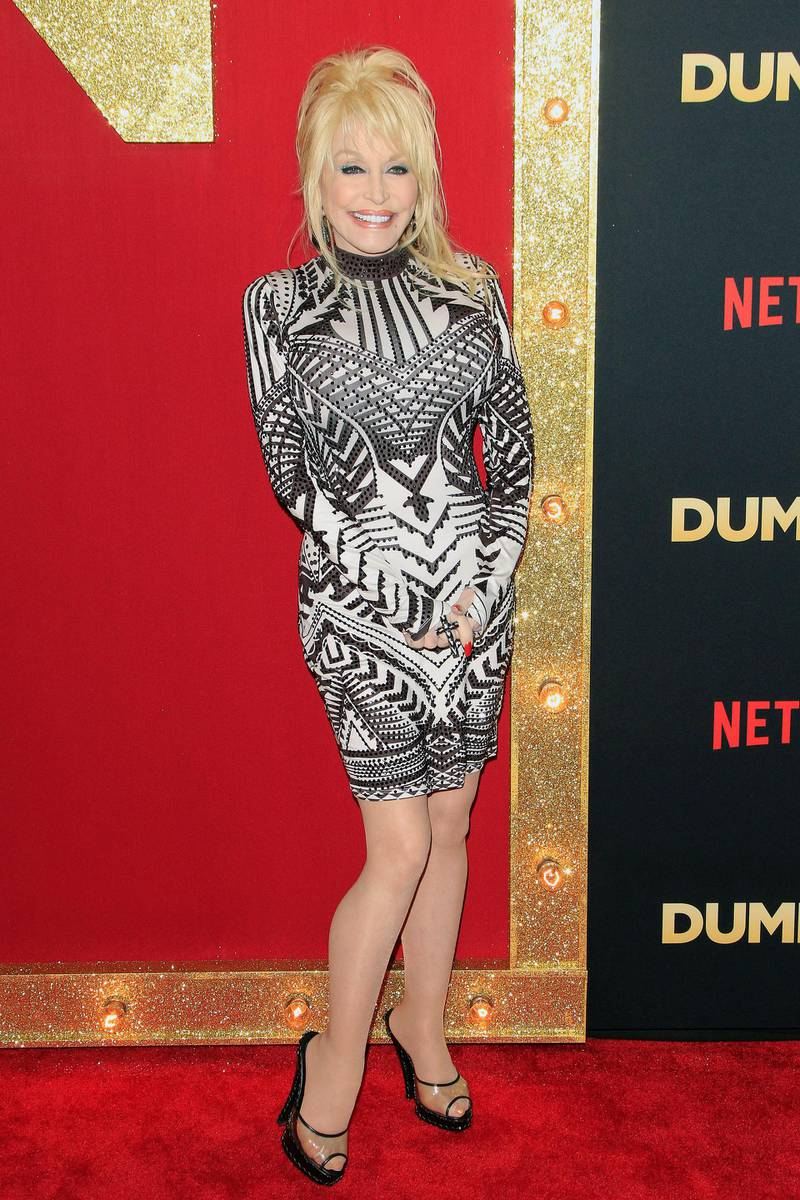 epa07214064 US actress/cast member Dolly Parton poses for photographers at the world premiere of the film Dumplin' at the TCL Chinese 6 Theaters in Hollywood, California, USA, 06 December 2018. The movie opens on Netflix and in select theaters 07 December 2018.  EPA-EFE/NINA PROMMER