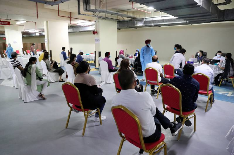 DUBAI, UNITED ARAB EMIRATES , Feb 6 – PEOPLE TAKING THE PCR TEST BEFORE GETING THE FIRST DOSE OF SINOPHARM VACCINATION DURING THE VACCINATION DRIVE AT THE GURU NANAK DARBAR GURUDWARA IN DUBAI. Guru Nanak Darbar Gurudwara has partnered with Tamouh Health Care LLC, to provide on-site Sinopharm Vaccination for all residents of the UAE free of charge on 6th, 7th & 8th February 2021. (Pawan Singh / The National) For News/Online