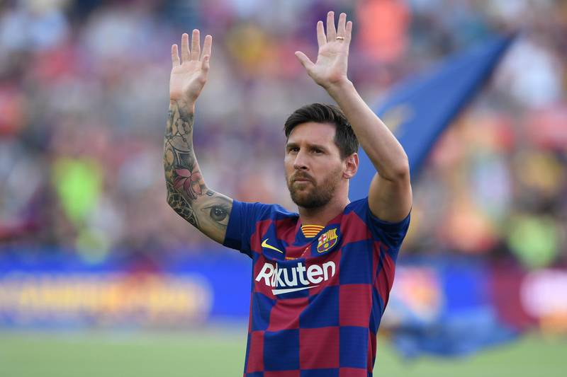 """(FILES) In this file photo taken on August 4, 2019 Barcelona's Argentinian forward Lionel Messi waves before the 54th Joan Gamper Trophy friendly football match between Barcelona and Arsenal at the Camp Nou stadium in Barcelona.  Six-time Ballon d'Or winner Lionel Messi told Barcelona he wants to leave -- on a free transfer -- in a """"bombshell"""" fax yesterday that is expected to spark a legal battle over a buy-out clause worth hundreds of millions of dollars. / AFP / Josep LAGO"""