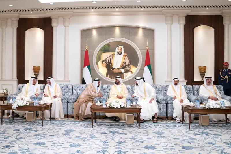 ABU DHABI, UNITED ARAB EMIRATES - June 15, 2018: (L-R) HH Sheikh Saud bin Saqr Al Qasimi, UAE Supreme Council Member and Ruler of Ras Al Khaimah, HH Sheikh Hamad bin Mohamed Al Sharqi, UAE Supreme Council Member and Ruler of Fujairah, HH Dr Sheikh Sultan bin Mohamed Al Qasimi, UAE Supreme Council Member and Ruler of Sharjah, HH Sheikh Mohamed bin Rashid Al Maktoum, Vice-President, Prime Minister of the UAE, Ruler of Dubai and Minister of Defence, HH Sheikh Mohamed bin Zayed Al Nahyan, Crown Prince of Abu Dhabi and Deputy Supreme Commander of the UAE Armed Forces, HH Sheikh Humaid bin Rashid Al Nuaimi, UAE Supreme Council Member and Ruler of Ajman and HH Sheikh Saud bin Rashid Al Mu'alla, UAE Supreme Council Member and Ruler of Umm Al Quwain, attend an Eid Al Fitr reception, at Mushrif Palace.  ( Hamad Al Kaabi / Crown Prince Court - Abu Dhabi ) —
