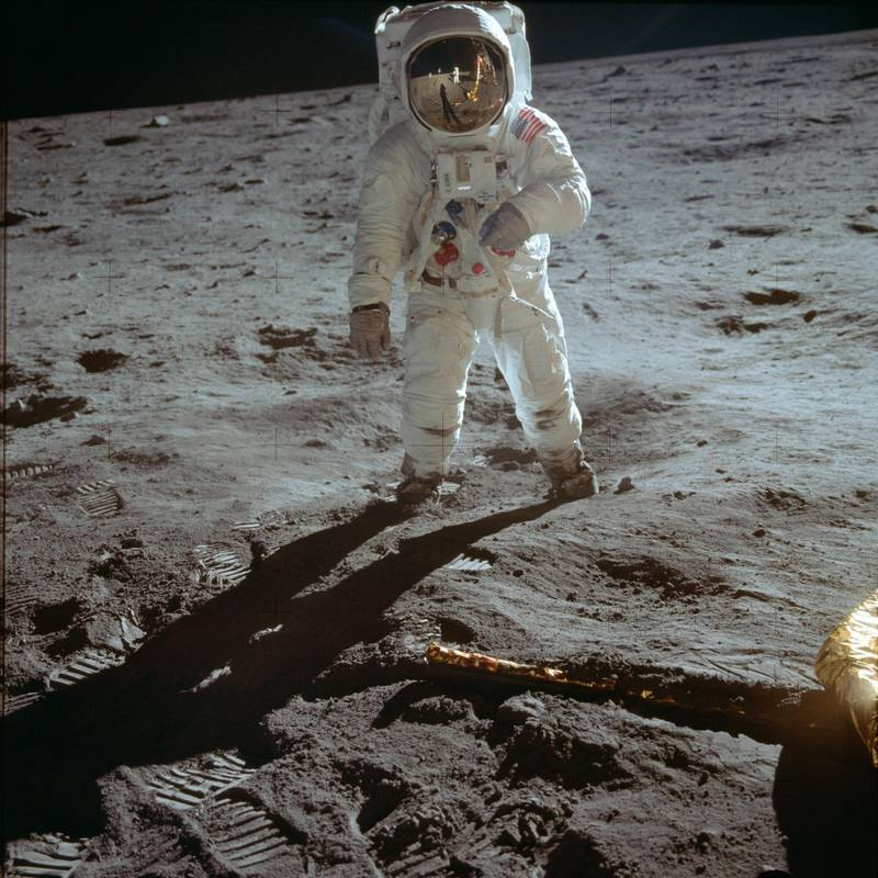 """In this July 20, 1969 photo made available by NASA, astronaut Buzz Aldrin, lunar module pilot, walks on the surface of the moon near the leg of the Lunar Module """"Eagle"""" during the Apollo 11 extravehicular activity. (Neil Armstrong/NASA via AP)"""