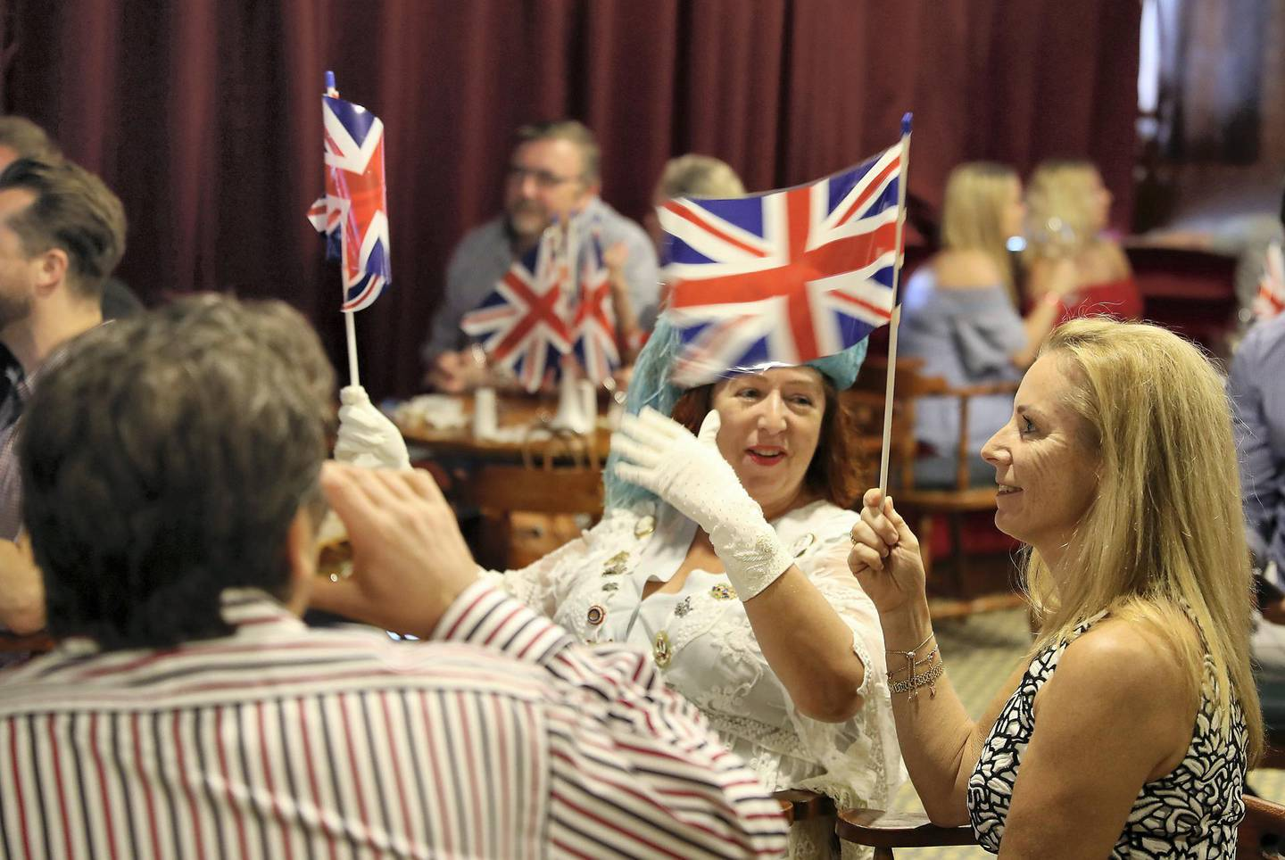 DUBAI , UNITED ARAB EMIRATES , MAY 19 – 2018 :- People watching the ceremony of British Royal Wedding at the Golden Lion Pub on the QE2 at Port Rashid in Dubai.  ( Pawan Singh / The National )  For News