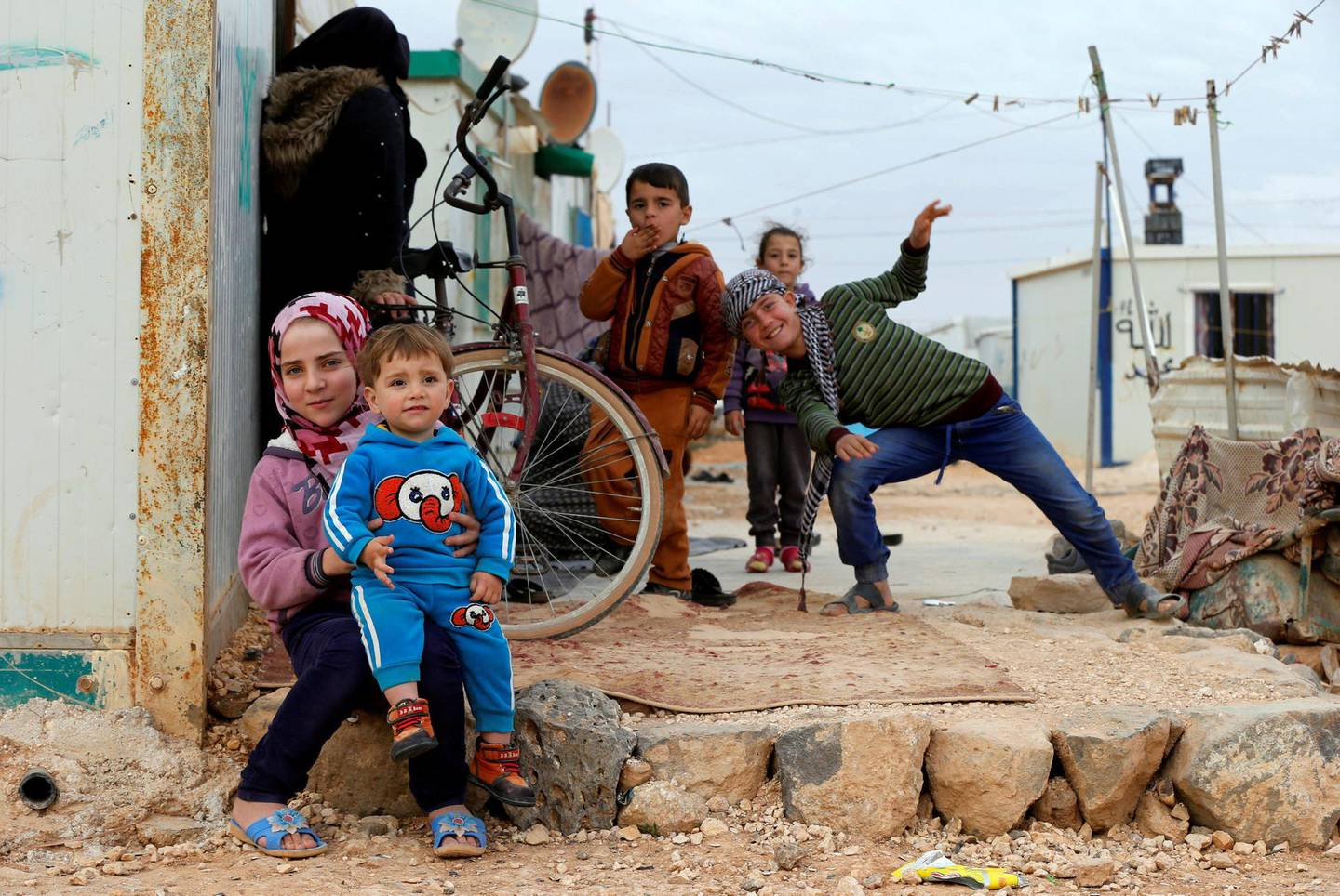 Syrian refugee children pose as they play at Al Zaatari refugee camp, in the Jordanian city of Mafraq, near the border with Syria, February 12, 2018. REUTERS/Muhammad Hamed