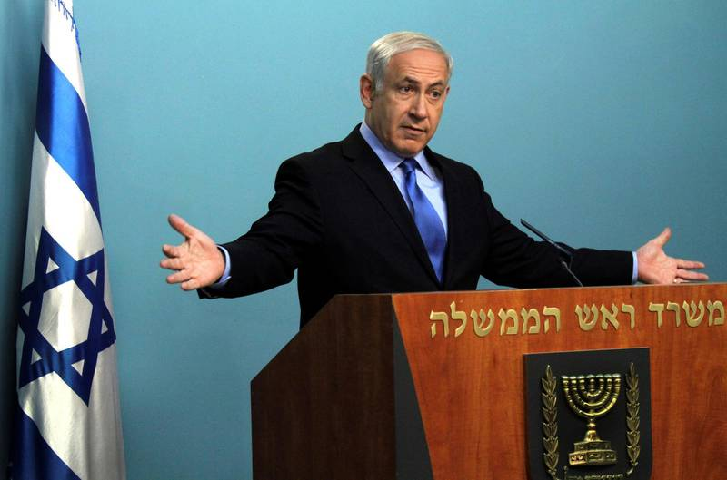 FILE PHOTO: Israeli Prime Minister Benjamin Netanyahu makes a statement concerning the release of abducted Israeli soldier, Gilad Shalit, in his office in Jerusalem July 1, 2010. REUTERS/Jim Hollander/Pool/File Photo