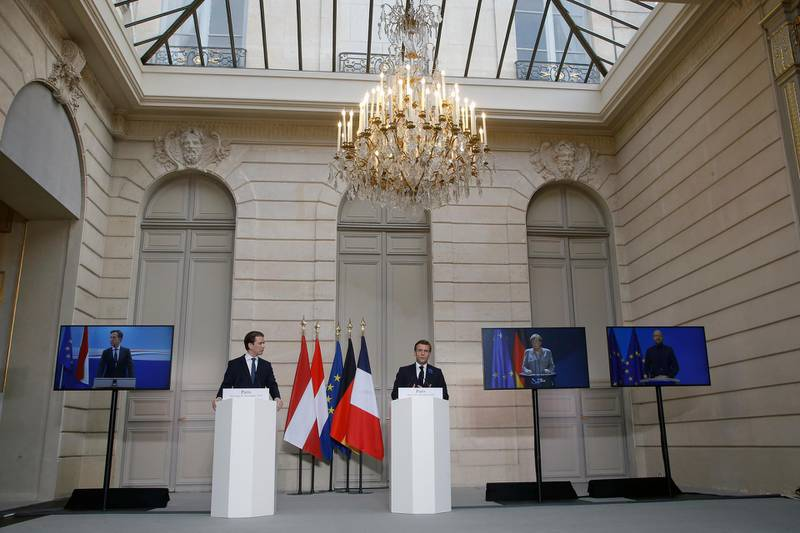 French President Emmanuel Macron, right, and Austrian Chancellor Sebastian Kurz arrive to attend a videoconference with Dutch Prime Minister Mark Rutte, left, German Chancellor Angela Merkel, European Council President Charles Michel, right, and European Commission President Ursula von der Leyen at the Elysee Palace, in Paris, Tuesday, Nov. 10, 2020. The leaders of France, Germany, Austria and the EU are meeting Tuesday to discuss Europe's response to terrorism threats after a string of attacks. Macron and Kurz are meeting in person after both of their countries have lost lives to Islamic extremist attackers in recent weeks. (AP Photo/Michel Euler, Pool)