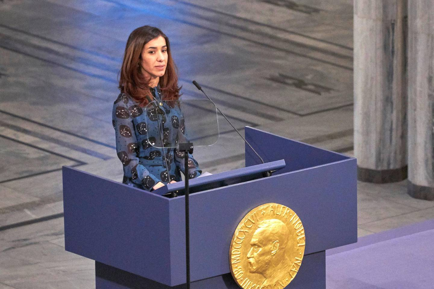 OSLO, NORWAY - DECEMBER 10:  Co-laureate of the 2018 Nobel Peace Prize Nadia Murad gives her lecture after accepting her award during the Nobel Peace Prize ceremony 2018 at Oslo City Town Hall on December 10, 2018 in Oslo, Norway. The Congolese gynaecologist, Denis Mukwege, who has treated thousands of rape victims, and Nadia Murad, the Iraqi Yazidi, who was sold into sex slavery by Isis, have been jointly awarded the 2018 Nobel peace prize in recognition for their efforts to end the use of sexual violence as a weapon in war.  (Photo by Erik Valestrand/Getty Images)