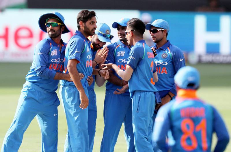 DUBAI , UNITED ARAB EMIRATES, September 19 , 2018 :- Bhuvneshwar Kumar ( 2nd left ) of India celebrating after taking the wicket of Imam ul Haq during the Asia Cup UAE 2018 cricket match between Pakistan vs India held at Dubai International Cricket Stadium in Dubai. ( Pawan Singh / The National )  For Sports. Story by Paul