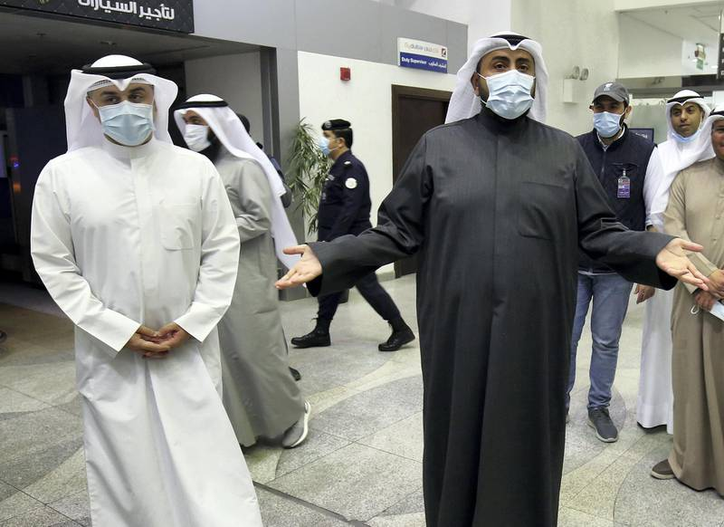 Kuwaiti health minister Sheikh Basel al-Sabah (R) speaks to the press at Sheikh Saad Airport in Kuwait City, on February 22, 2020, as Kuwaitis returning from Iran wait before being taken to a hospital to be tested for coronavirus. - Iran ordered the closure of schools, universities and cultural centres after a coronavirus outbreak that has killed five people in the Islamic republic, the most outside the Far East. (Photo by YASSER AL-ZAYYAT / AFP)