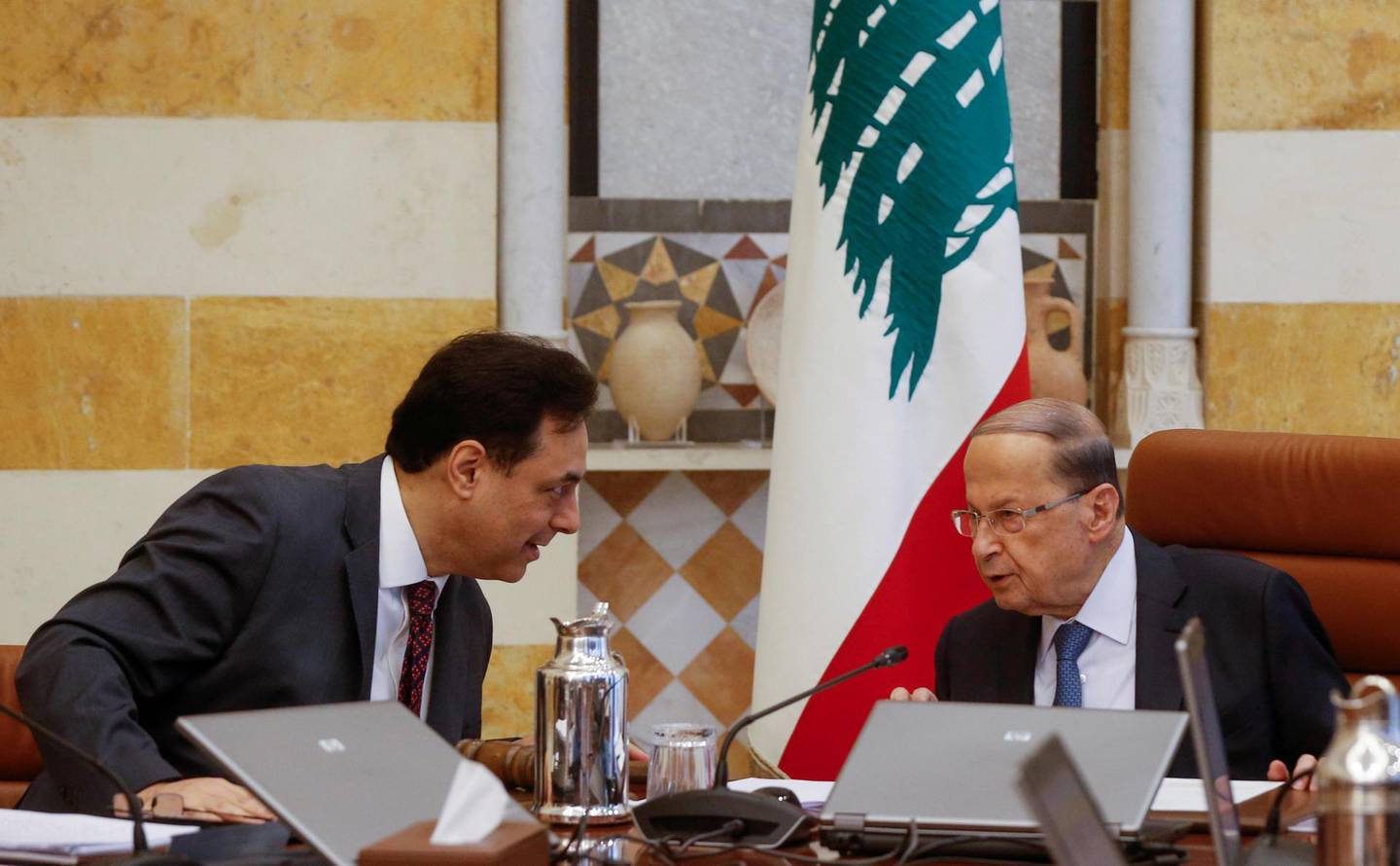 FILE PHOTO: Lebanon's Prime Minister Hassan Diab speaks with Lebanon's President Michel Aoun during a cabinet meeting at the presidential palace in Baabda, Lebanon February 6, 2020. REUTERS/Mohamed Azakir/File Photo