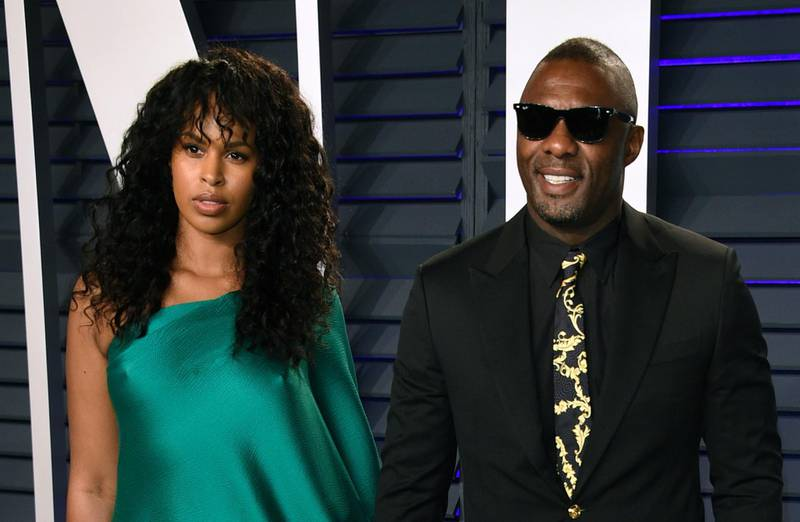 """FILE - In this Sunday, Feb. 24, 2019 file photo, Idris Elba, right, and Sabrina Dhowre arrive at the Vanity Fair Oscar Party in Beverly Hills, Calif. British actor Idris Elba has married model Sabrina Dhowre in Morocco. Images featured by British Vogue on Instagram on Saturday, April 27, 2019 showed the star of """"Luther'' sharing an embrace with Dhowre, a former Miss Vancouver. The magazine says the couple exchanged vows Friday at the Ksar Char Bagh hotel in Marrakesh. (Photo by Evan Agostini/Invision/AP, File)"""