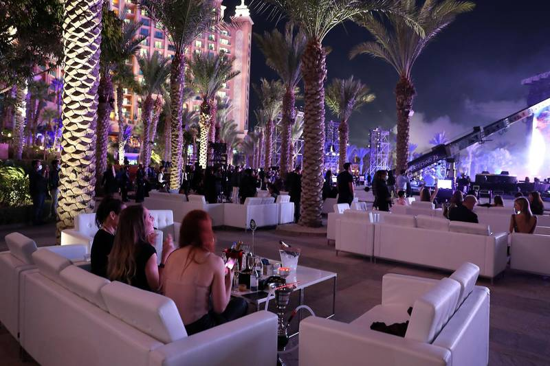 DUBAI, UNITED ARAB EMIRATES , December 31 – 2020 :- People enjoying the performance of the rock band Kiss during the New Year's Eve at the Atlantis hotel on Palm Jumeirah in Dubai. ( Pawan Singh / The National ) For News/Standalone/Online/Instagram. Story by Saeed