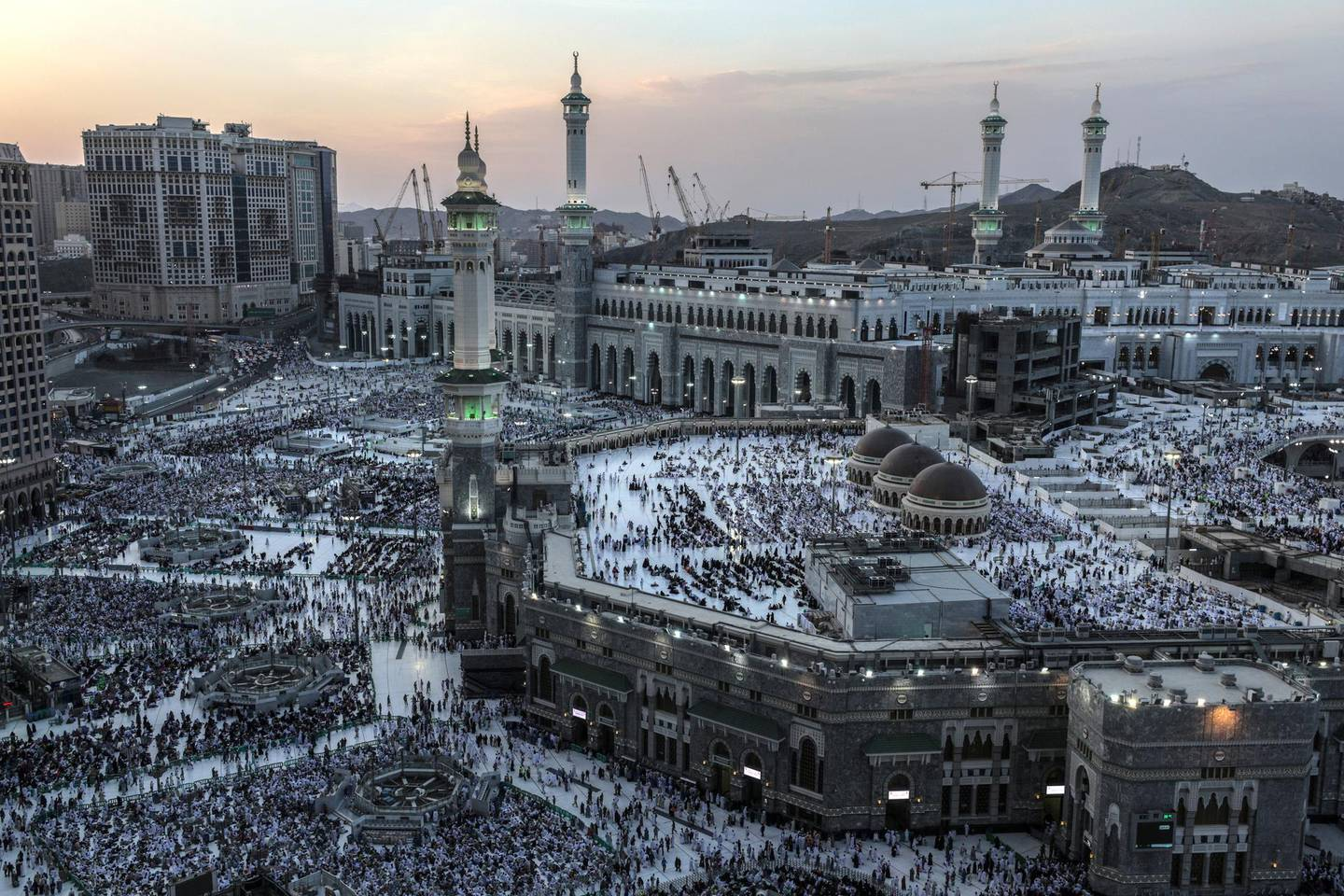 epa06958157 Muslim pilgrims pray around the holy Kaaba at the Grand Mosque in Mecca, Saudi Arabia, 18 August 2018 (issued 19 August 2018). Around 2.5 million Muslims are expected to attend this year's Hajj pilgrimage, which is highlighted by the Day of Arafah, one day prior to Eid al-Adha. Eid al-Adha is the holiest of the two Muslims holidays celebrated each year, it marks the yearly Muslim pilgrimage (Hajj) to visit Mecca, the holiest place in Islam.  EPA/MOHAMMED SABER