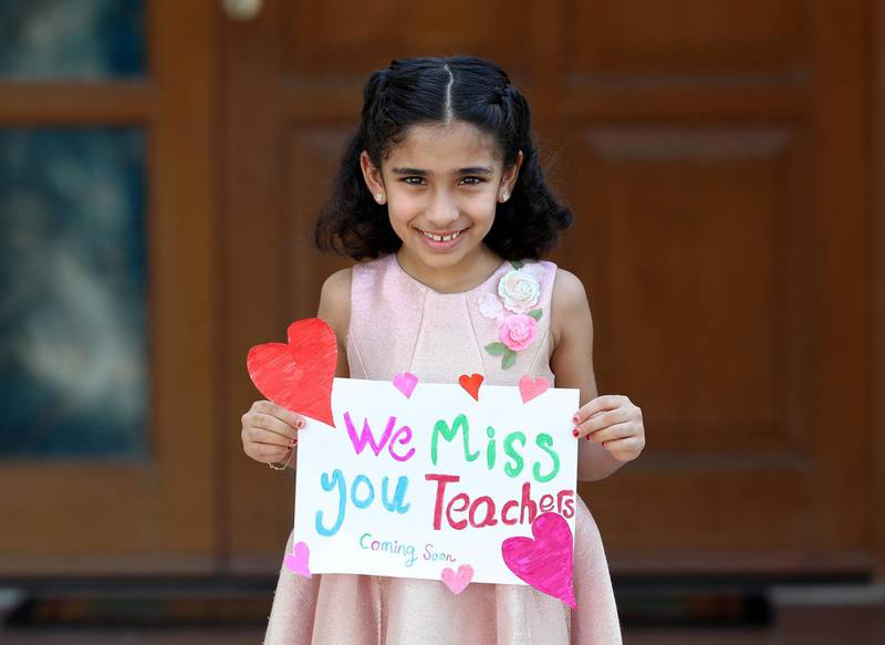"""Dubai, United Arab Emirates - Reporter: N/A. Photo Project. Missing our teachers. Shamma Tahlak, aged 8 from the UAE and her teachers are Miss Hannah, Miss Kholoud, Miss Doa and Miss Rahaf at GEMS national school for girls. """"We miss you teachers, coming soon"""". Monday, June 8th, 2020. Dubai. Chris Whiteoak / The National"""