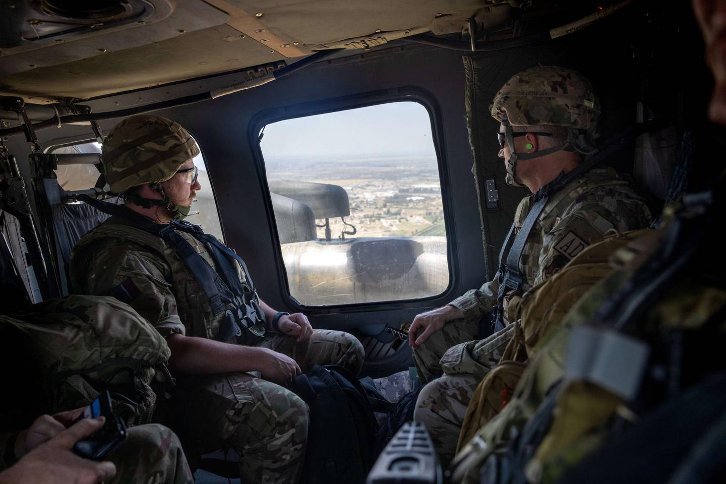 BAGHDAD, IRAQ - MAY 31: Coalition soldiers fly to Baghdad International Airport from the International Zone in a U.S. Blackhawk helicopter on May 31, 2021 in Baghdad, Iraq. Coalition forces based in Baghdad's International Zone are part of the U.S.-led Military Advisor Group of 13 nations supporting the Iraqi Security Forces.   John Moore/Getty Images/AFP == FOR NEWSPAPERS, INTERNET, TELCOS & TELEVISION USE ONLY ==