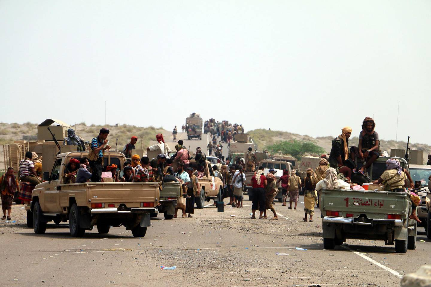 epa06768610 Yemeni government forces backed by the Saudi-led coalition take position at an area after seizing it from the Houthi militia in the western province of Hodeidah, Yemen, 27 May 2018 (issued 28 May 2018). According to reports, Yemeni troops backed by the Saudi-led coalition have moved closer to a key Houthis-held port and strategic city of Hodeidah after Yemeni government forces seized Houthis-held areas along the western coast. Most of Yemen's food and medicine imports and aid are shipped through Hodeidah port.  EPA/STRINGER