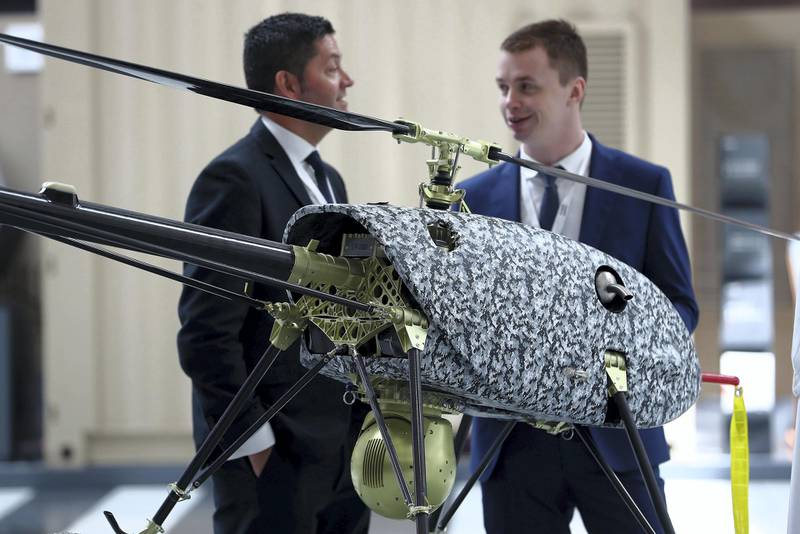 ABU DHABI, UNITED ARAB EMIRATES , Feb 23  – 2020 :- Visitors looking ISR 350-5 drone on the first day of the UMEX & SimTEX held at Abu Dhabi National Exhibitions Centre in Abu Dhabi. (Pawan  Singh / The National) For News/Online/Instagram.  Story by Kelsey Warner