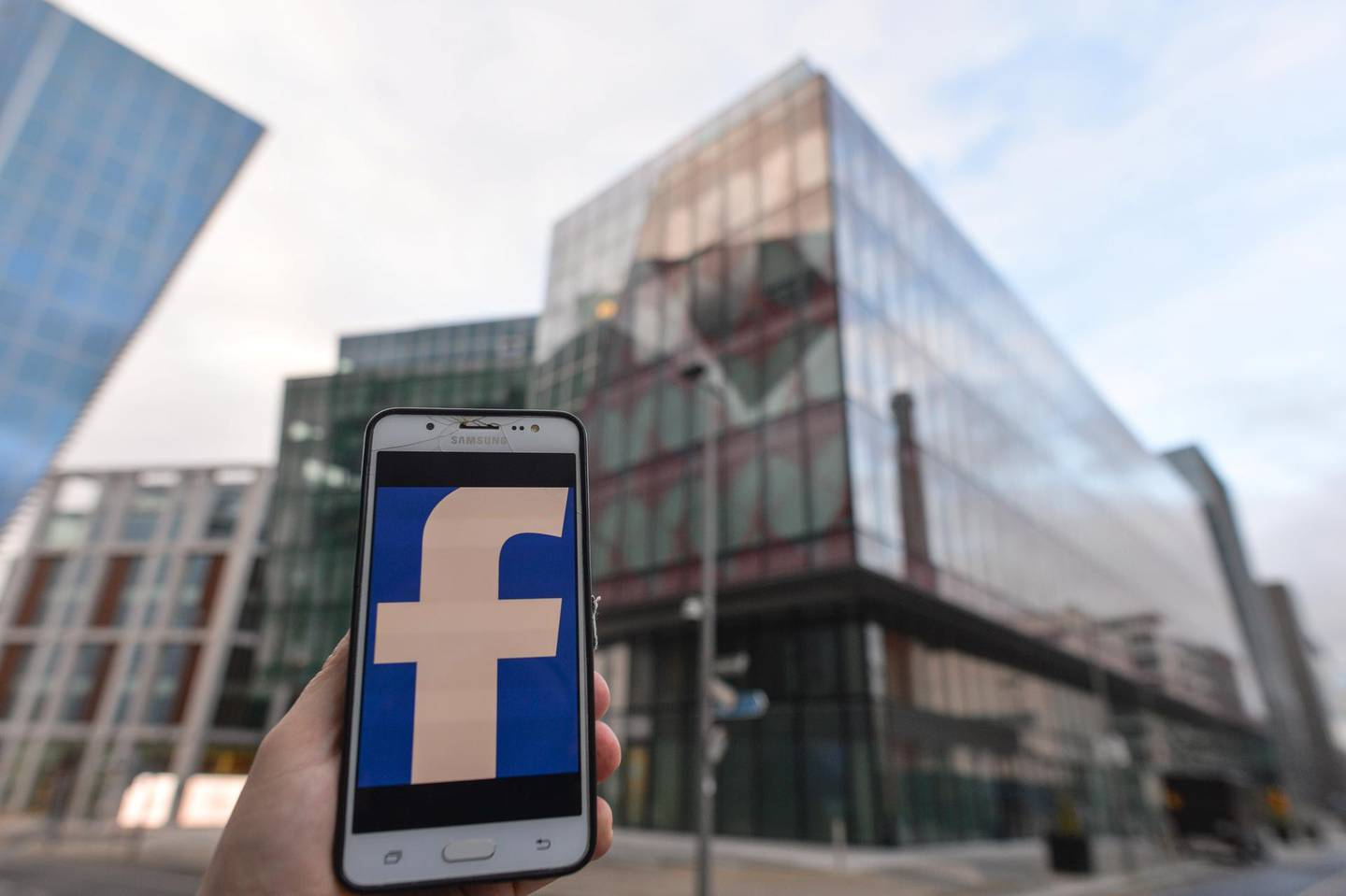 Facebook logo displayed on a mobile phone in front of Facebook EMEA headquarters on Grand Canal Square in Dublin Docklands. On Friday, 29 January, 2021, in Dublin, Ireland. (Photo by Artur Widak/NurPhoto via Getty Images)