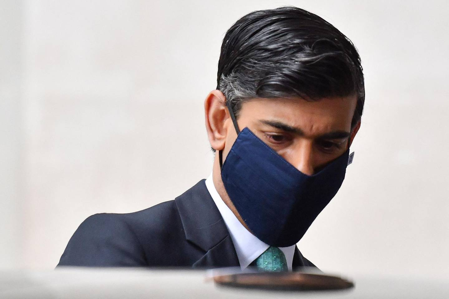 Britain's Chancellor of the Exchequer Rishi Sunak, wearing a protective face covering to combat the spread of the coronavirus, leaves the BBC in central London on February 28, 2021, after appearing on the BBC political programme The Andrew Marr Show.  Britain is to launch a new Infrastructure Bank with £12 billion ($17 bn, 14 bn euros) in capital and £10 billion in government guarantees, the Treasury said Saturday, aimed at kickstarting the economy. Rishi Sunak is expected to announce the initial funding at Wednesday's Budget and the bank will launch in spring, the Treasury said.  / AFP / Justin TALLIS