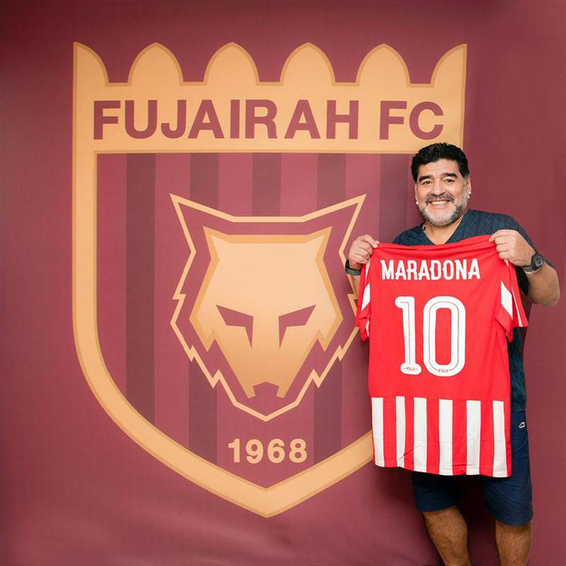RESIZED. Diego Maradona poses alongside the Fujairah logo following his appointment as manager in May. Courtesy Fujairah Football Club