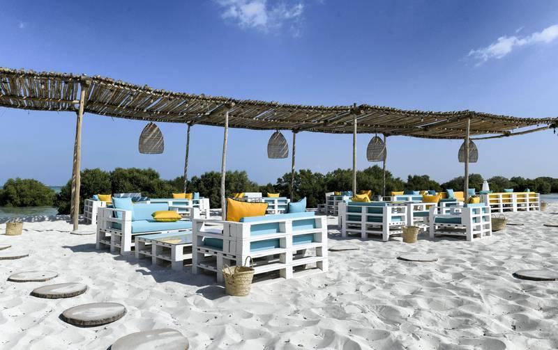 Abu Dhabi, United Arab Emirates - Outdoor seating for dinner at Pure Eco Retreat on Jubail Island. Khushnum Bhandari for The National