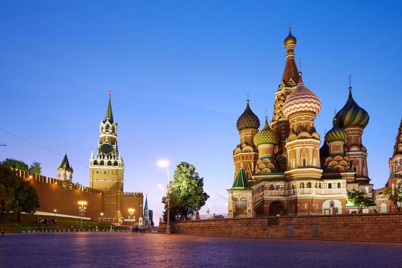 The buildings located on the Red Square: Kremlin wall (at left) and Saint Basil's Cathedral (at right), Moscow, Russia. UNESCO World Heritage Site
