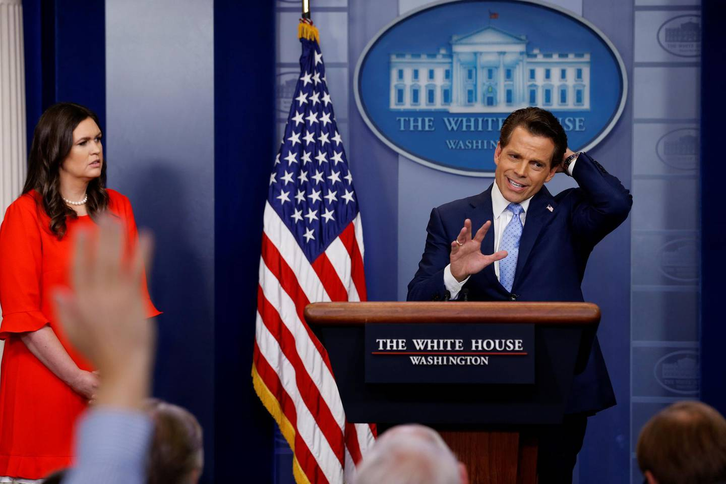 FILE PHOTO: White House Communications Director Anthony Scaramucci, flanked by White House Press Secretary Sarah Sanders, speaks at the daily briefing at the White House in Washington, U.S. July 21, 2017. REUTERS/Jonathan Ernst/File Photo
