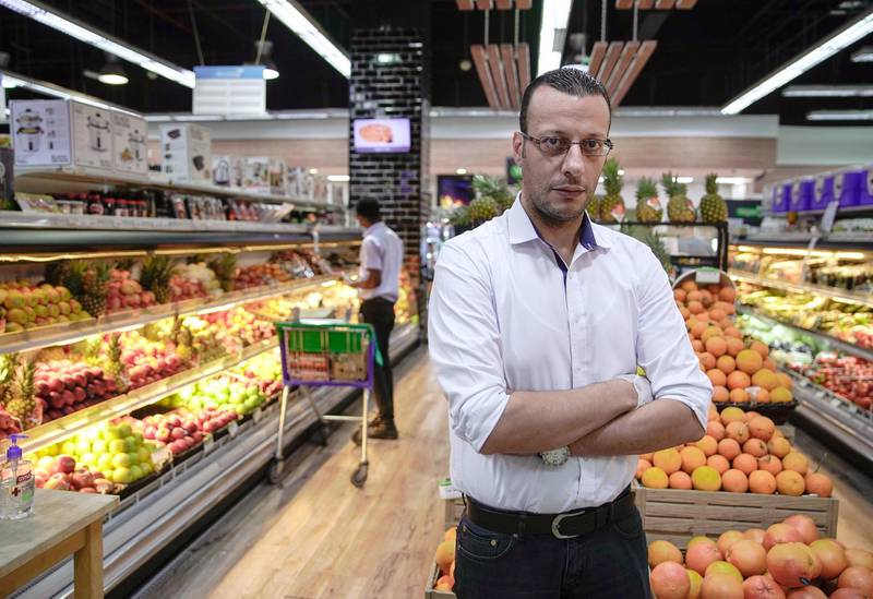 Abu Dhabi, United Arab Emirates, March 26, 2020. Photo project - Unsung heroes of the UAE.Name:  Mutaz KamalAge:  31   Profession:  Manager at Souq Planet, Etihad PlazaNationality: Jordanian--  We are fortunate at the Souq Planet because our mother compay, National Catering Company, also manufactures cleaning products.  Our sister company, Aman Lab products.  Hand sanitizers are found in almost every area in our store.  Even at the front parking area, we have a designated sanitizer table ready for entering customers.Photographer:  Victor Besa / The NationalSection:  NAReporter: