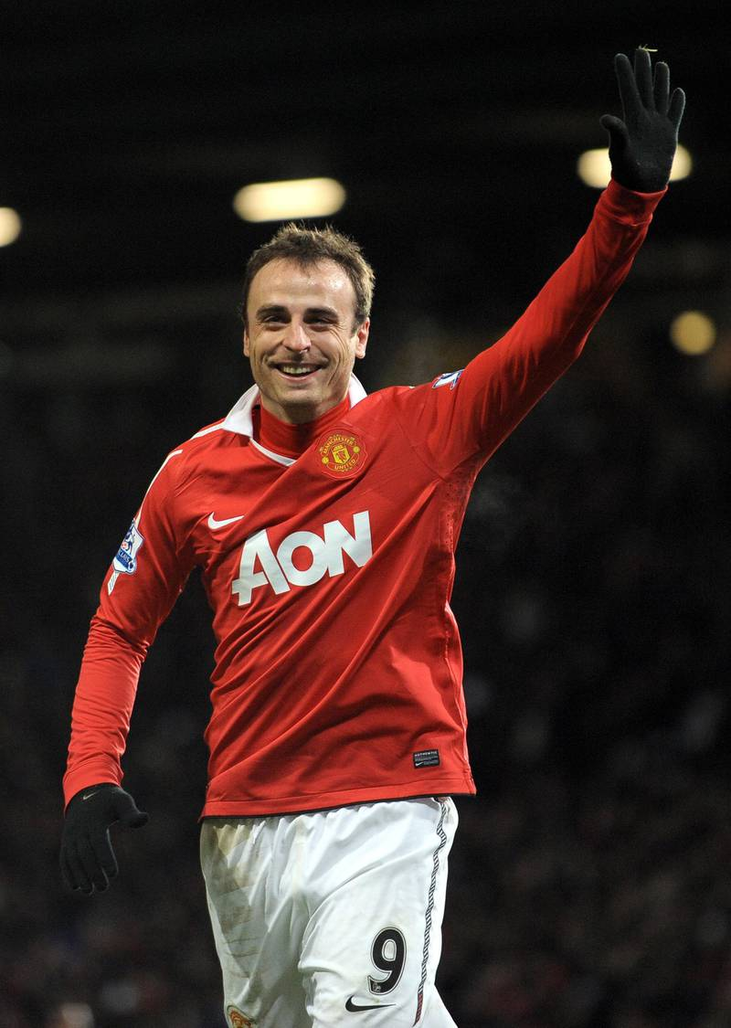 Manchester United's Bulgarian striker Dimitar Berbatov celebrates after scoring his fifth goal during the English Premier League football match between Manchester United and Blackburn Rovers at Old Trafford in Manchester, north-west England on November 27, 2010. Manchester United won the game 7-1. AFP PHOTO/ANDREW YATES  FOR  EDITORIAL USE Additional licence required for any commercial/promotional use or use on TV or internet (except identical online version of newspaper) of Premier League/Football League photos. Tel DataCo +44 207 2981656. Do not alter/modify photo (Photo by ANDREW YATES / AFP)