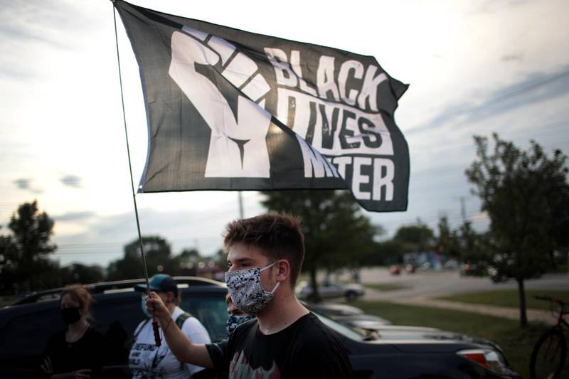 KENOSHA, WISCONSIN - AUGUST 28: A small group of peaceful demonstrators protesting the shooting of Jacob Blake hold a rally on August 28, 2020 in Kenosha, Wisconsin. Blake was shot seven times in the back in front of his three children by a police officer. The shooting has led to several days of rioting and protests in the city.   Scott Olson/Getty Images/AFP == FOR NEWSPAPERS, INTERNET, TELCOS & TELEVISION USE ONLY ==