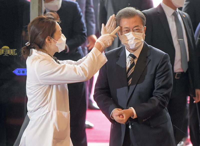 South Korean President Moon Jae-in gets temperature tested upon his arrival at the National Assembly in Seoul, South Korea, February 28, 2020.    Yonhap via REUTERS   ATTENTION EDITORS - THIS IMAGE HAS BEEN SUPPLIED BY A THIRD PARTY. SOUTH KOREA OUT. NO RESALES. NO ARCHIVE.