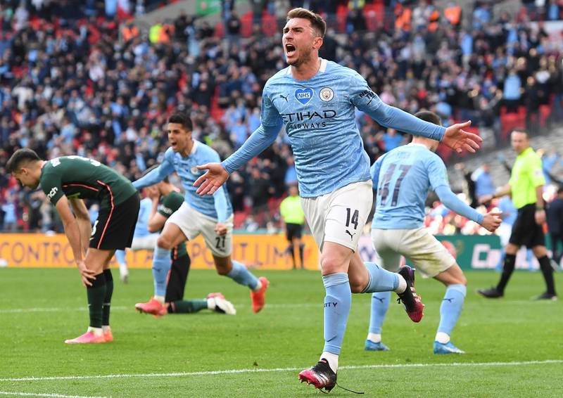 epa09159094 Manchester City's Aymeric Laporte (front) celebrates after scoring the 1-0 lead during the Carabao Cup Final between Manchester City and Tottenham Hotspur at Wembley in London, Britain, 25 April 2021.  EPA/ANDY RAIN EDITORIAL USE ONLY. No use with unauthorized audio, video, data, fixture lists, club/league logos or 'live' services. Online in-match use limited to 120 images, no video emulation. No use in betting, games or single club/league/player publications.