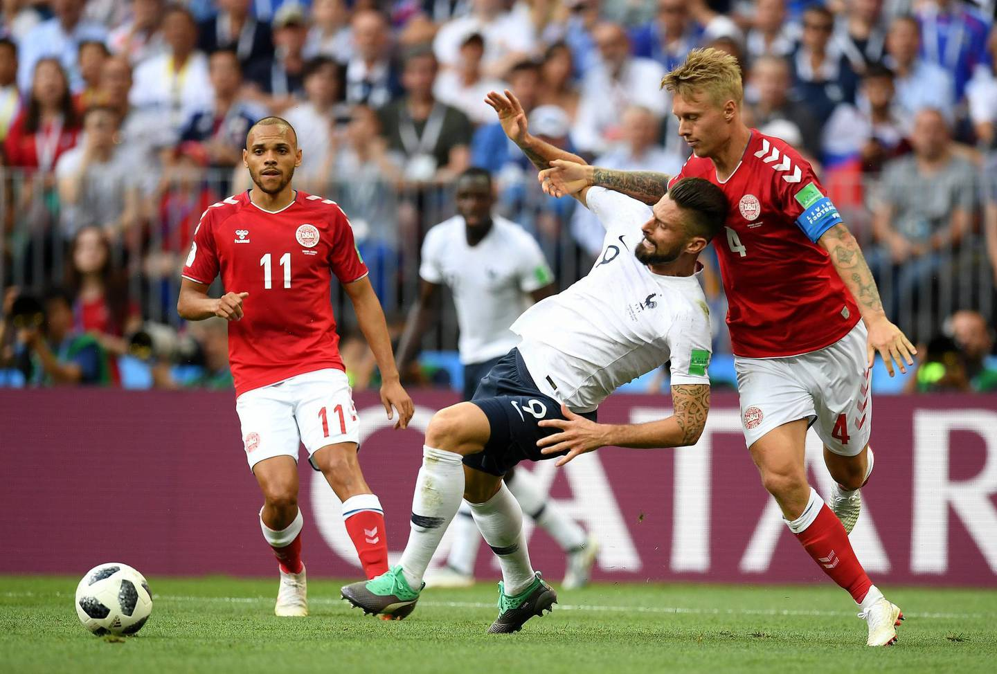 MOSCOW, RUSSIA - JUNE 26:  Olivier Giroud of France is tackled by Simon Kjaer of Denmark during the 2018 FIFA World Cup Russia group C match between Denmark and France at Luzhniki Stadium on June 26, 2018 in Moscow, Russia.  (Photo by Matthias Hangst/Getty Images)