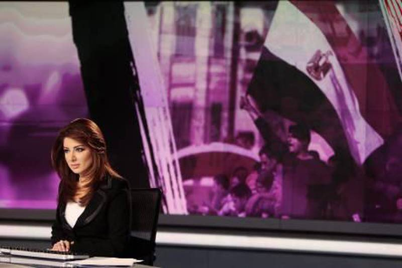 News anchor Rola Ibrahim is seen in the studio of the Arabic Al Jazeera satellite news channel in Doha in this February 7, 2011 file photo. Over the past few weeks, much has been made of the power of Al Jazeera, the Qatari news channel launched 15 years ago by the Gulf Arab state's Emir Sheikh Hamad bin Khalifa al-Thani with the goal of providing the sort of independent news that the region's state-run broadcasters had long ignored. It was Al Jazeera that first grasped the enormity of the Tunisia uprising and its implications for the region, and Al Jazeera which latched onto -- critics would say fuelled -- subsequent rumblings in Egypt. And audiences around the world responded: the network's global audience has rocketed. To match Special Report ALJAZEERA/       REUTERS/Fadi Al-Assaad/Files  (QATAR  - Tags: MEDIA BUSINESS) *** Local Caption ***  QAT09_ALJAZEERA-_0217_11.JPG