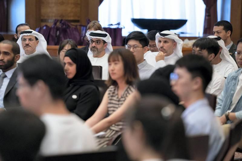BEIJING, CHINA - July 23, 2019: (back L-R) HE Sultan bin Saeed Al Mansouri, UAE Minister of Economy, HH Sheikh Hamed bin Zayed Al Nahyan, Chairman of the Crown Prince Court of Abu Dhabi and Abu Dhabi Executive Council Member and HE Khaldoon Khalifa Al Mubarak, CEO and Managing Director Mubadala, Chairman of the Abu Dhabi Executive Affairs Authority and Abu Dhabi Executive Council Member, attend the UAE-China youth symposium, at Tsinghua University.  ( Hamed Al Mansoori for the Ministry of Presidential Affairs ) ---