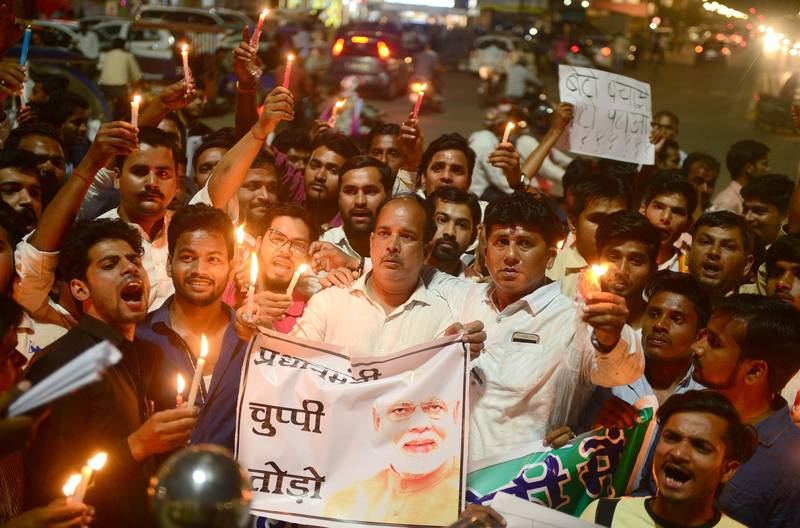 (FILES) In this file photo taken on April 13, 2018 Indian Congress workers participate in a candle light procession as they shout slogans against Indian Prime Minister Narendra Modi during a protest against rape incidents, in Allahabad. Indian police have made another arrest after the alleged rape of a teenager by a ruling party politician fanned protests across the country, federal investigators said April 15.  / AFP PHOTO / SANJAY KANOJIA