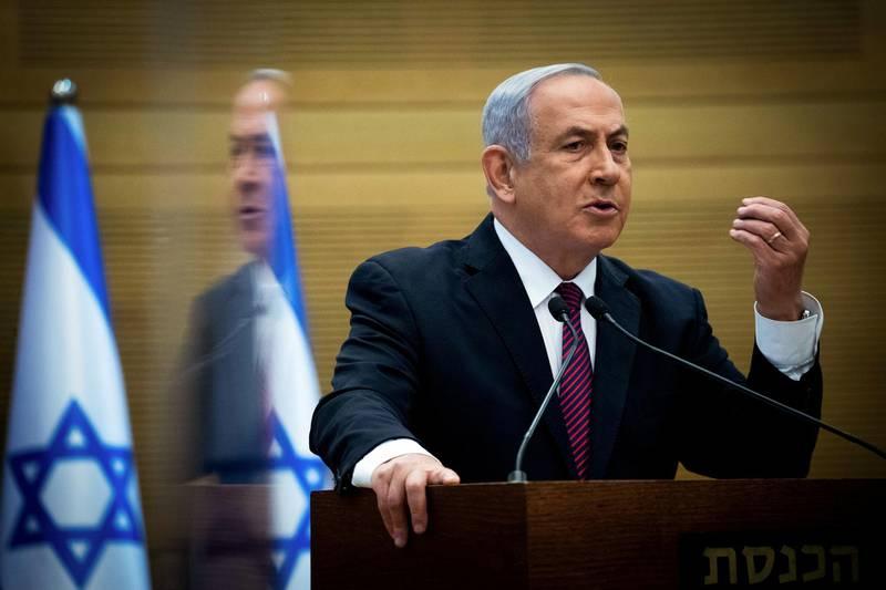 FILE PHOTO: Israeli Prime Minister Benjamin Netanyahu delivers a statement to Likud party MKs at the Knesset (Israel's parliament) in Jerusalem, December 2, 2020. Yonatan Sindel/Pool via REUTERS/File Photo