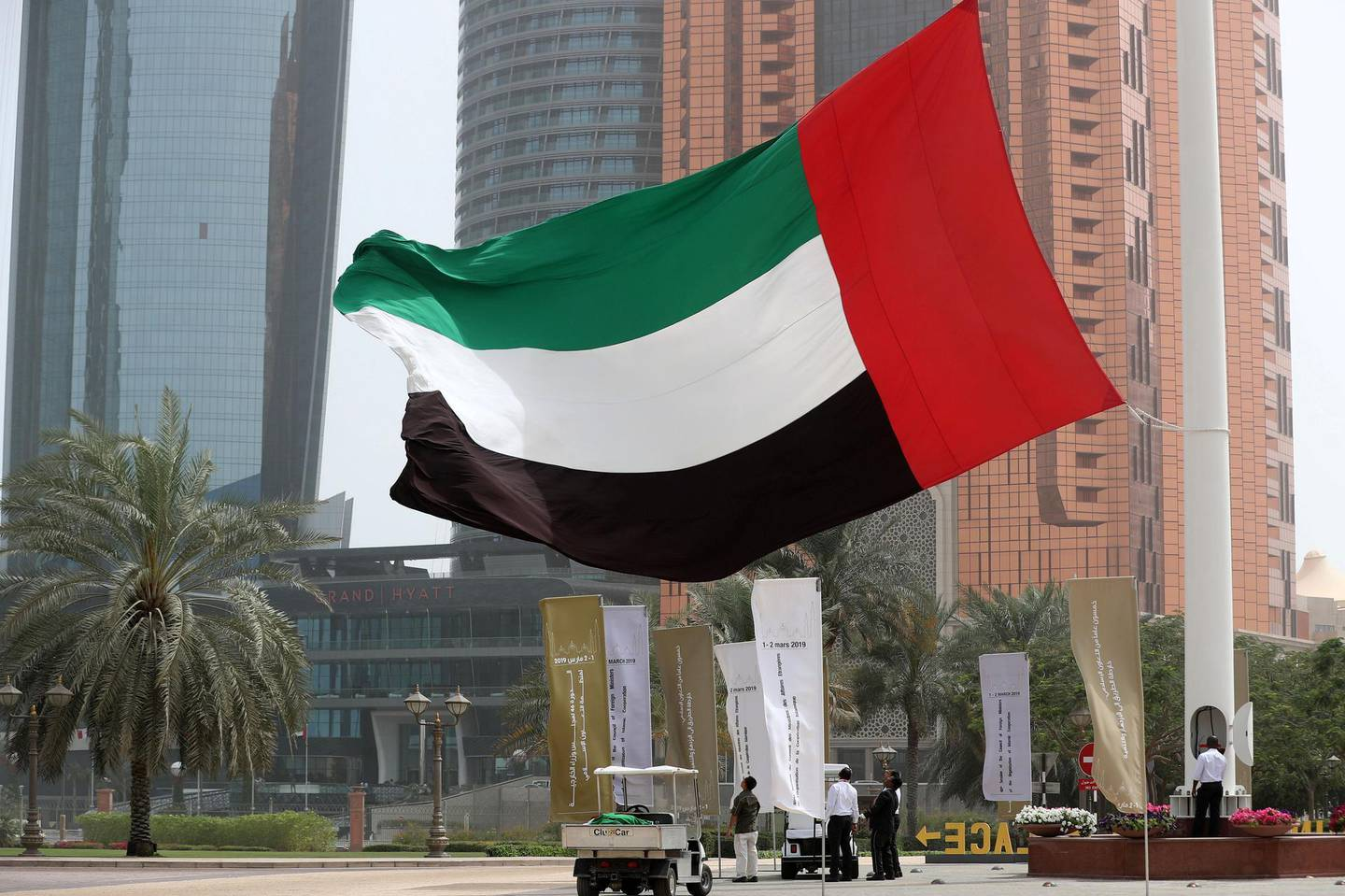 Abu Dhabi, United Arab Emirates - March 01, 2019: The UAE flag is replaced by a new one as the wind blows strong in Abu Dhabi. Friday the 1st of March 2019 at Emirates Palace, Abu Dhabi. Chris Whiteoak / The National