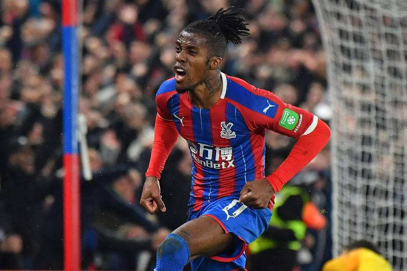 (FILES) In this file photo taken on December 16, 2019 Crystal Palace's Ivorian striker Wilfried Zaha celebrates after scoring their first goal during the English Premier League football match between Crystal Palace and Brighton and Hove Albion at Selhurst Park. Crystal Palace winger Wilfried Zaha has offered free accommodation to medical staff in his London properties as they treat patients with coronavirus. - RESTRICTED TO EDITORIAL USE. No use with unauthorized audio, video, data, fixture lists, club/league logos or 'live' services. Online in-match use limited to 120 images. An additional 40 images may be used in extra time. No video emulation. Social media in-match use limited to 120 images. An additional 40 images may be used in extra time. No use in betting publications, games or single club/league/player publications.  / AFP / Ben STANSALL / RESTRICTED TO EDITORIAL USE. No use with unauthorized audio, video, data, fixture lists, club/league logos or 'live' services. Online in-match use limited to 120 images. An additional 40 images may be used in extra time. No video emulation. Social media in-match use limited to 120 images. An additional 40 images may be used in extra time. No use in betting publications, games or single club/league/player publications.