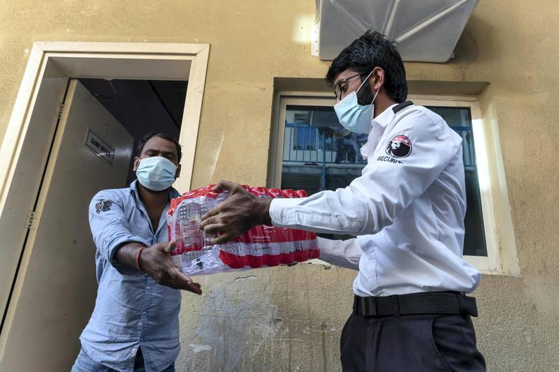 The Sri Lanka community distributes three hundred / 300 meals to workers at the Fakhruddin Camp in Sonapur, Dubai with the help of the to Al Watani volunteers and the CDA on April 23 rd, 2021. Antonie Robertson / The National.Reporter: Ramola Talwar for National